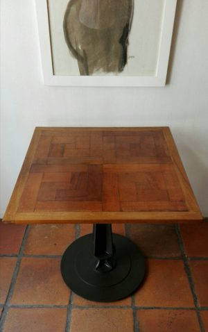 Table created from reclaimed parquet on steel pedestal base