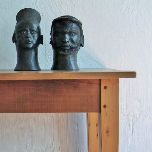 Pair of clay African heads