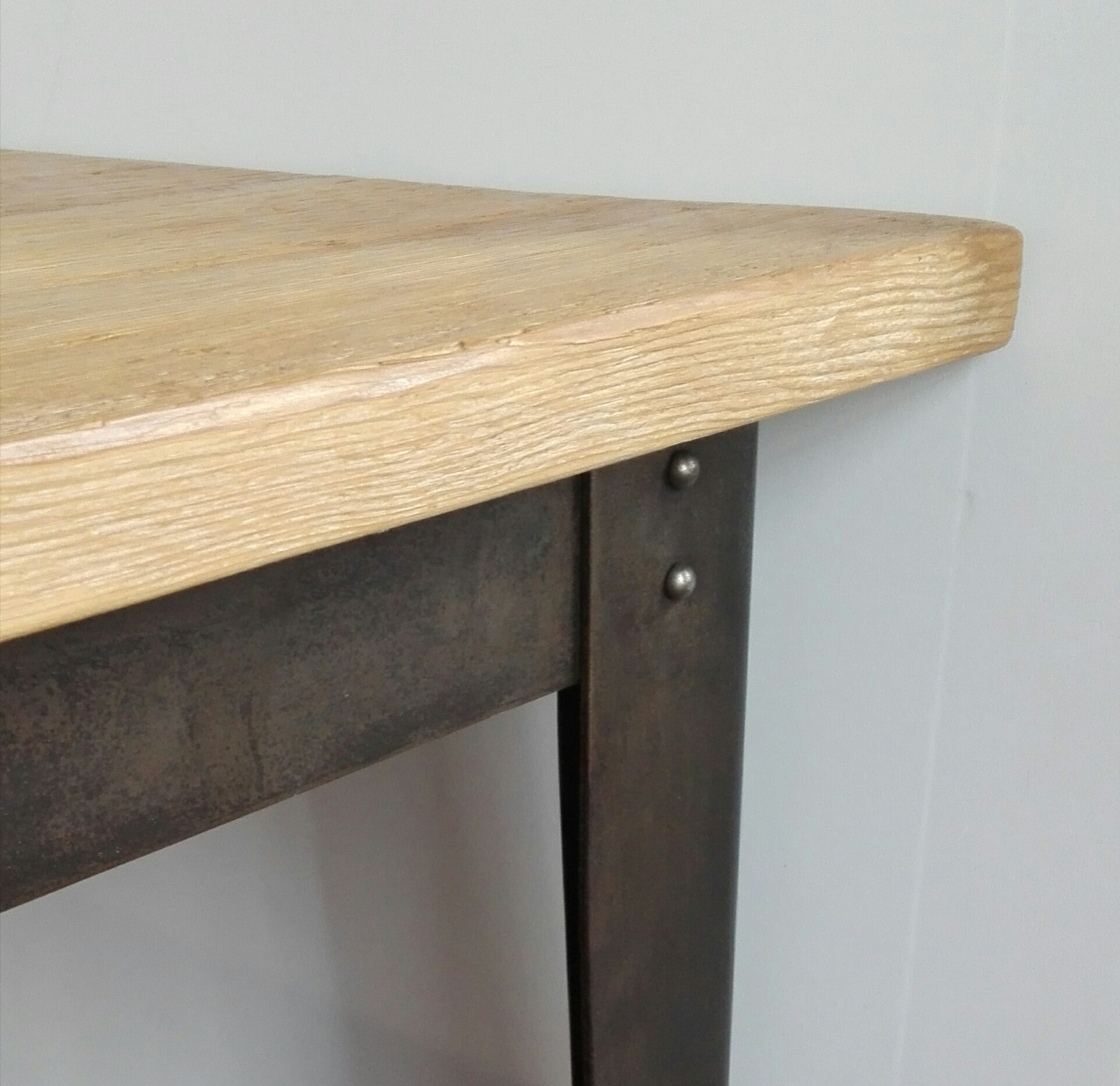 Table made from reclaimed 19th century Oregon and metal base