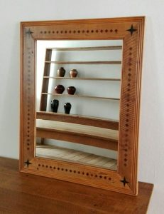 Mirror frame created from reclaimed 19th century yellowwood with stinkwood and ebony inlay