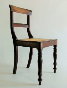 Set of four 19th century Cape stinkwood caned chairs