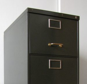 Steel filing cabinet with brass fittings