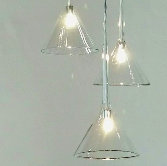 Photograph of hanging lights created by Riaan Chambers from reclaimed laboratory glass.